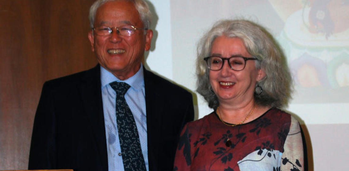 George Tanabe and Janet Gyatso stand side by side smiling